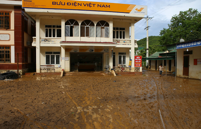 Many public places in the town, including a post office are still flooded in the mud.