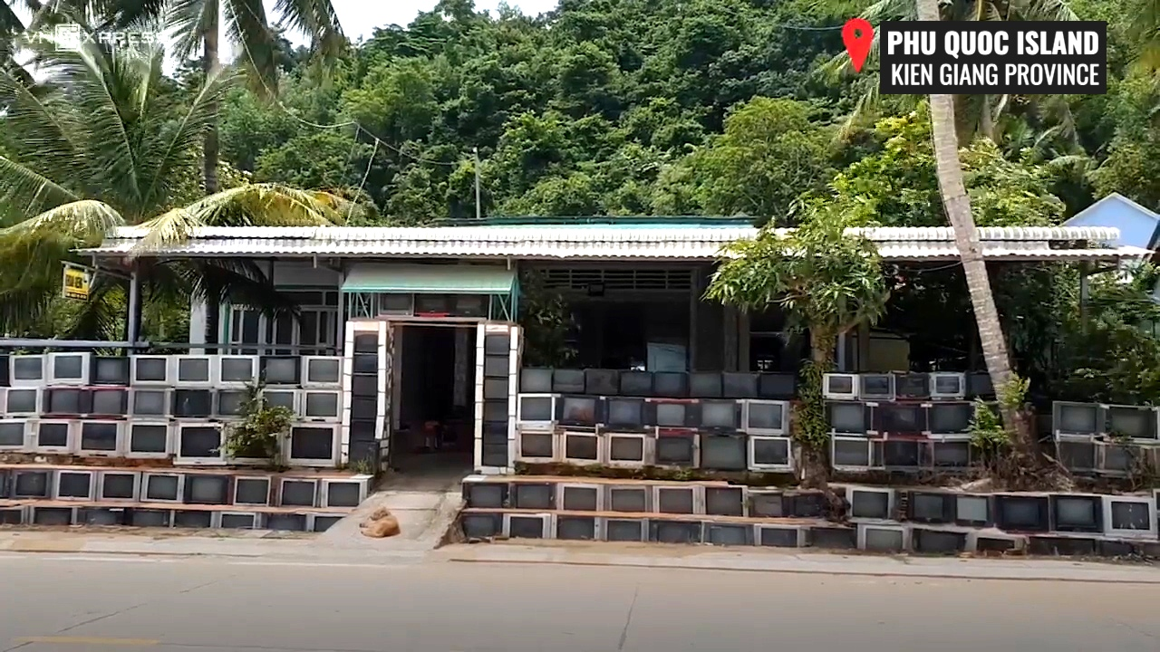 This house in Vietnam has a fence made entirely of 400 TV sets
