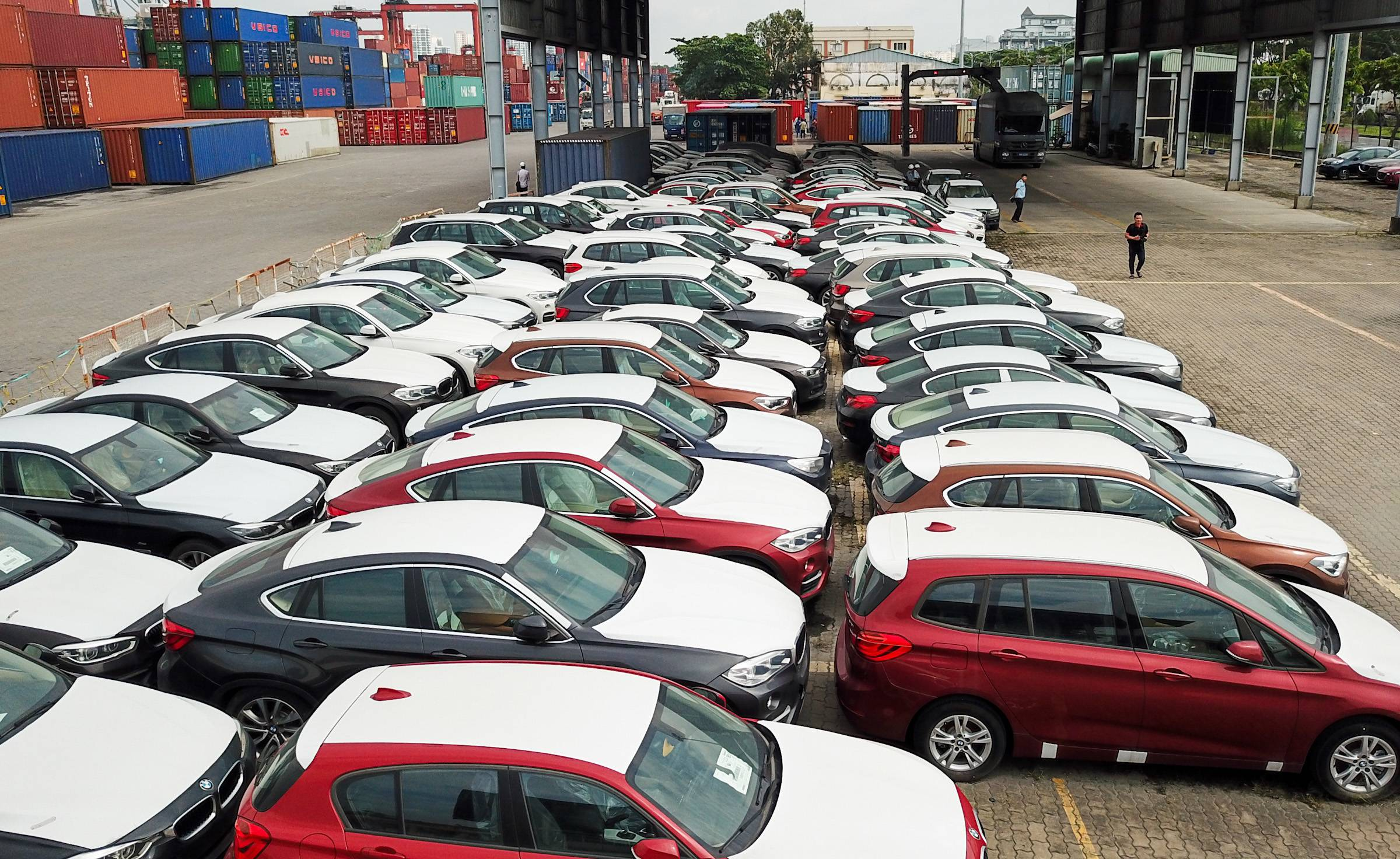 Hundreds of shiny new BMW cars rust away at HCMC port