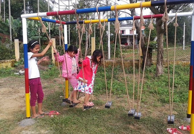 The children play at the Phuoc Thang Village Community House. Photo by Dac Thanh
