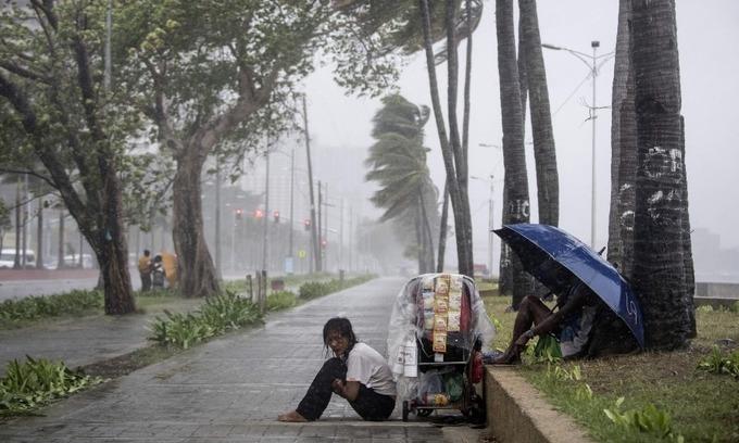 Dozens feared buried in Philippines typhoon landslide