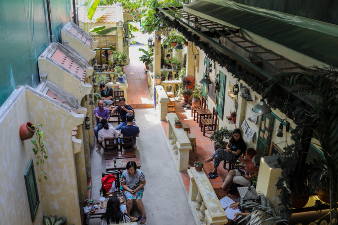 Pay a visit to last centurys Hanoi in this Saigon café - 1
