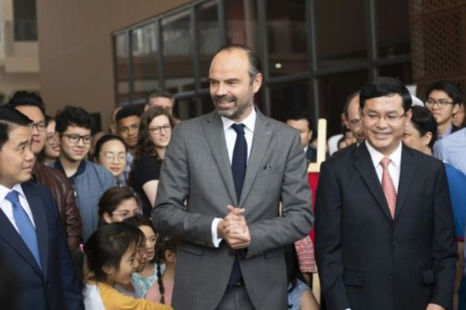French Prime Minister Edouard Philippe (C) speaks after inaugurating the newly-built Alexandre Yersin School in Hanoi on November 3, 2018. Photo by AFP/Jewel Samad