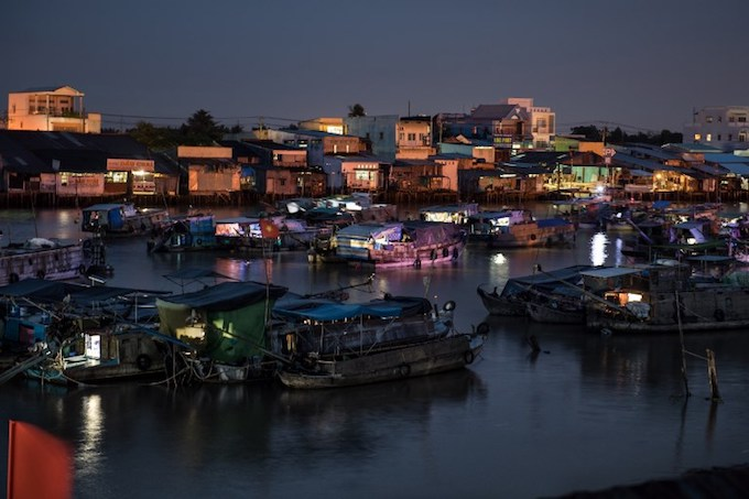 Boats lie anchored in a canal off the Song Hau River in the floating Cai Rang Market in Can Tho. Photo by AFP/Roberto Schmidt