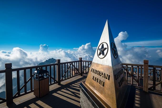 The monument at the summit of Fansipan, the highest peak in Vietnam. Photo by Shutterstock/Ekkalak Ngamjarasvanji