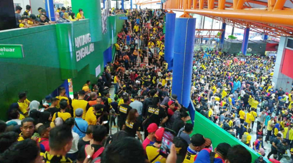 Malaysian fans arrive at the stadium four hours after the game.
