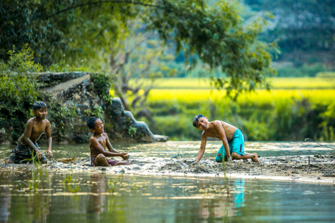 Boys play on a small pond in Pu Luong Nature Reserve. Photo by VnExpress/Tran Huy Thang