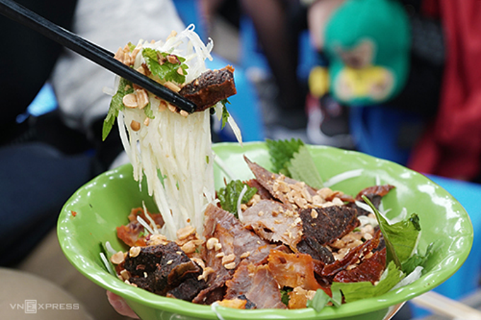 Dried beef salad is a specialty on Hanoi's Ho Hoan Kiem Street. Photo by VnExpress/Di Vy