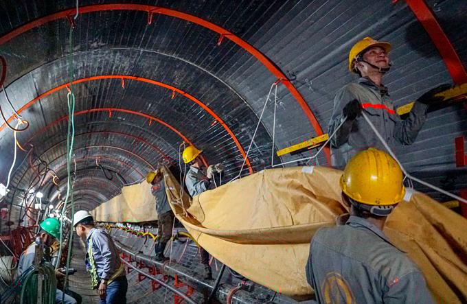 Down into Saigons biggest underground sewer system