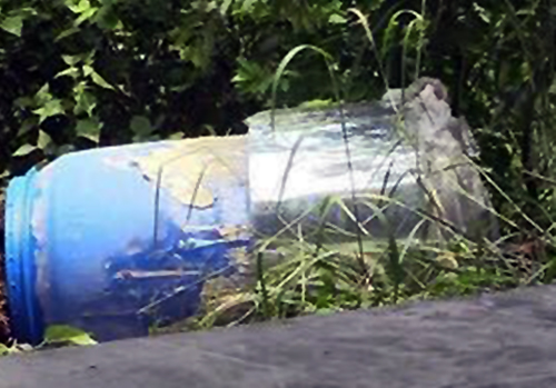The water tank where police found the second body. Photo by VnExpress/Nguyet Trieu