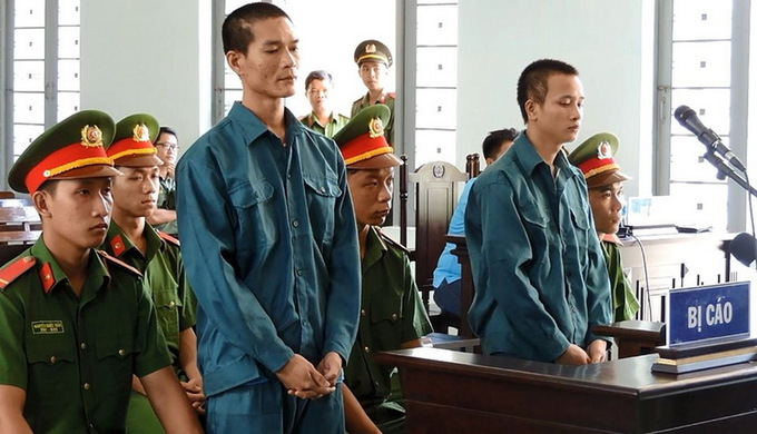 Two jailed in Vietnam for burning police cars during last year's SEZ law protests