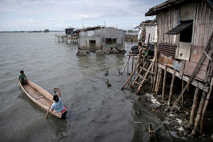 At least 5,000 people have been forced out of the mostly rural coastal areas north of Manila in recent decades as the bay water has moved further inland.