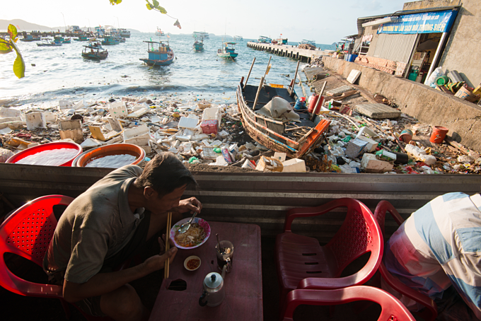 A man was eating breakfast in TKien Giang province in southern Vietnam. Photo by Nguyen Viet Hung