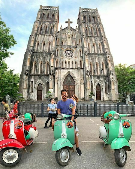 Sulaiman sits on a vespa while visiting the iconic St. Josephs Cathedral in Hanoi. Photo courtesy of Sulaiman Roudan.