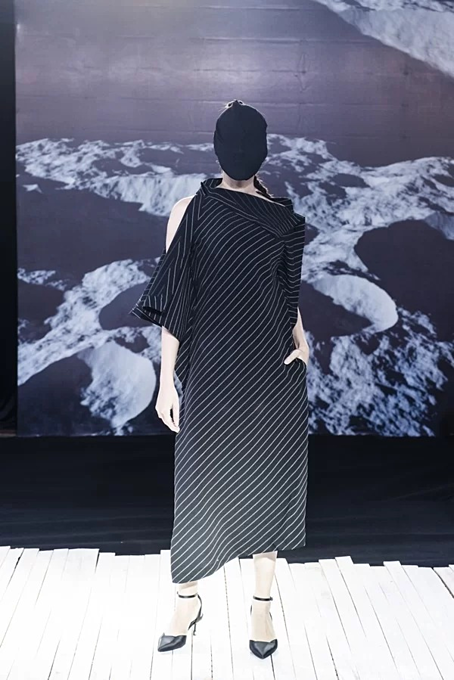 Vietnamese designer presents new twists in latest collection - 4