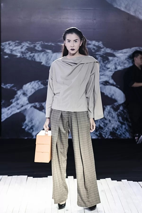 Vietnamese designer presents new twists in latest collection - 5