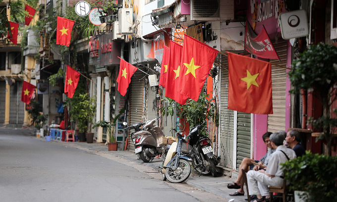 People fly Vietnams national flag in front of their houses in Hanoi for the National Day of September 2, 2019. Photo by VnExpress/Giang Huy.