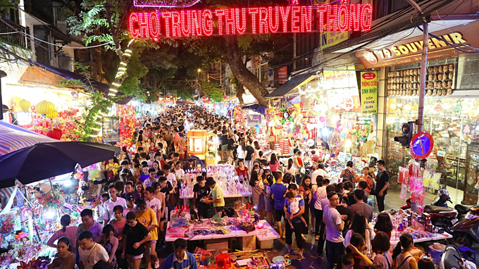 These days, Hang Ma Street, one of the busiest areas in the capital specializing in trading children's toys, paper goods and paper votive offerings, turned into a traditional market during the Mid-Autumn season.The street, which has exister for hundreds of years and a hidden gem of Hanoi normally sells paper votive offerings and home decorations but one month before the festival, it has transformed into a busy shopping area with almost houses and sidewalks turned into makeshift shops, providing star-shaped lanterns, revolving lanterns, and paper masks of animals and fairy tales characters for the childrens favorite festival.For many Vietnamese, the Mid-Autumn Festival, which falls on September 13 this year, is the second most important festival after the Lunar New Year.  The Mid-Autumn festival dates back to the Rice Civilization of the Red River delta, over 4,000 years ago.
