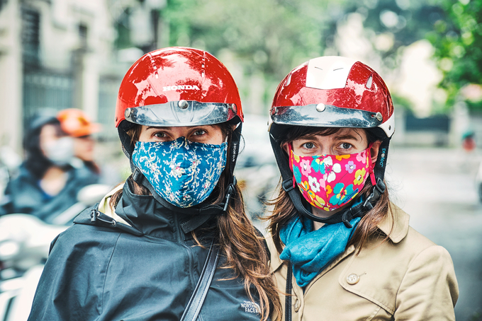 Two axpats wearing masks in Hanoi. Photo by Shuttlestock/Jaem Prungeangwet.