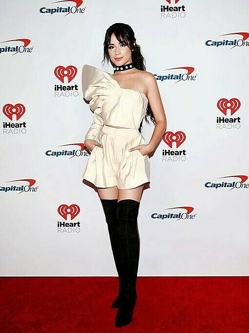 The American-CubansingerCamila Cabellochose abeigeone-sleeved top featuring a puffed shoulder for the 2019 iHeartRadio Music Festival in September. Photo by AFP.