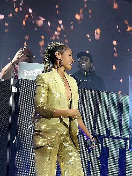 Jada Pinkett Smith (L) chose a gold suit to attend her husbands birthday last month. Photo by Facebook/Cong Tri.