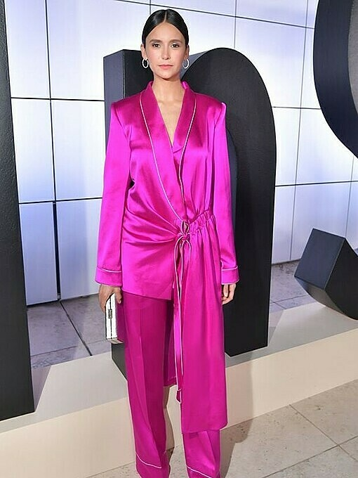 Nina Dobrev from the American drama series Vampire Diaries rocked a pajama-inspired fuchsia pantsuit by Cong Tri at the 2019 InStyle Awards in Octoter. Photo by Facebook/Cong Tri.