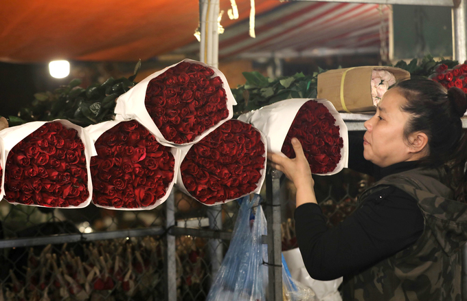 Red roses always pull lots of customers on Valentine's, but traders say they can only offload around half of their stocks this year. Although we have ordered less flowers this year, we only sold around half. Because of the epidemic, everybody is too scared to go out and buy anything. Demand has fallen around 70 percent compared to last year, when we didn't even have flowers left to sell, said Nhi, owner of a flower shop.