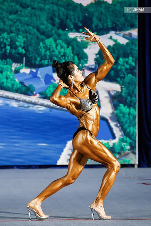 Ny competing in a bodybuilding tournament. Photo courtesy of Ny.