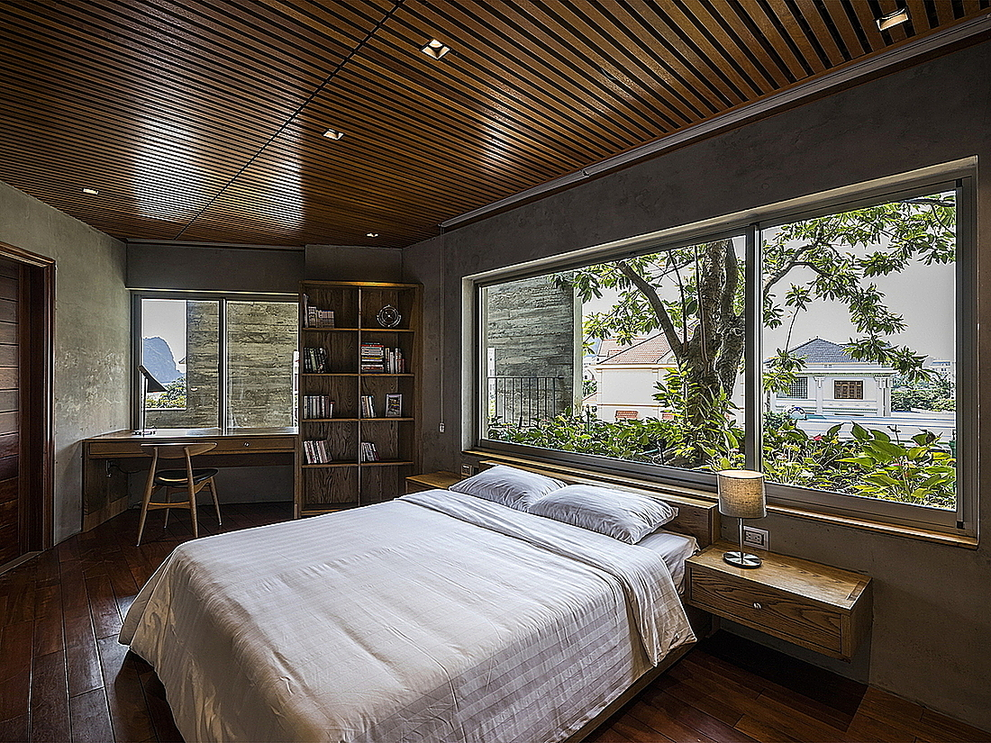 Bedroom with a view of greenery.