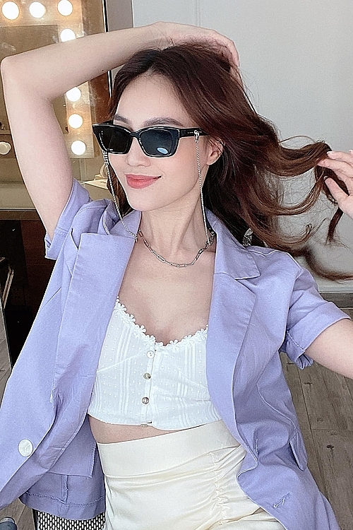 Actress Ninh Duong Lan Ngoc goes trendy with a purple blazer for her white shirt. One of 2020's biggest fashion trend is a powdery pastel palette of lilac and lavender, hues dubbed millennial purple.