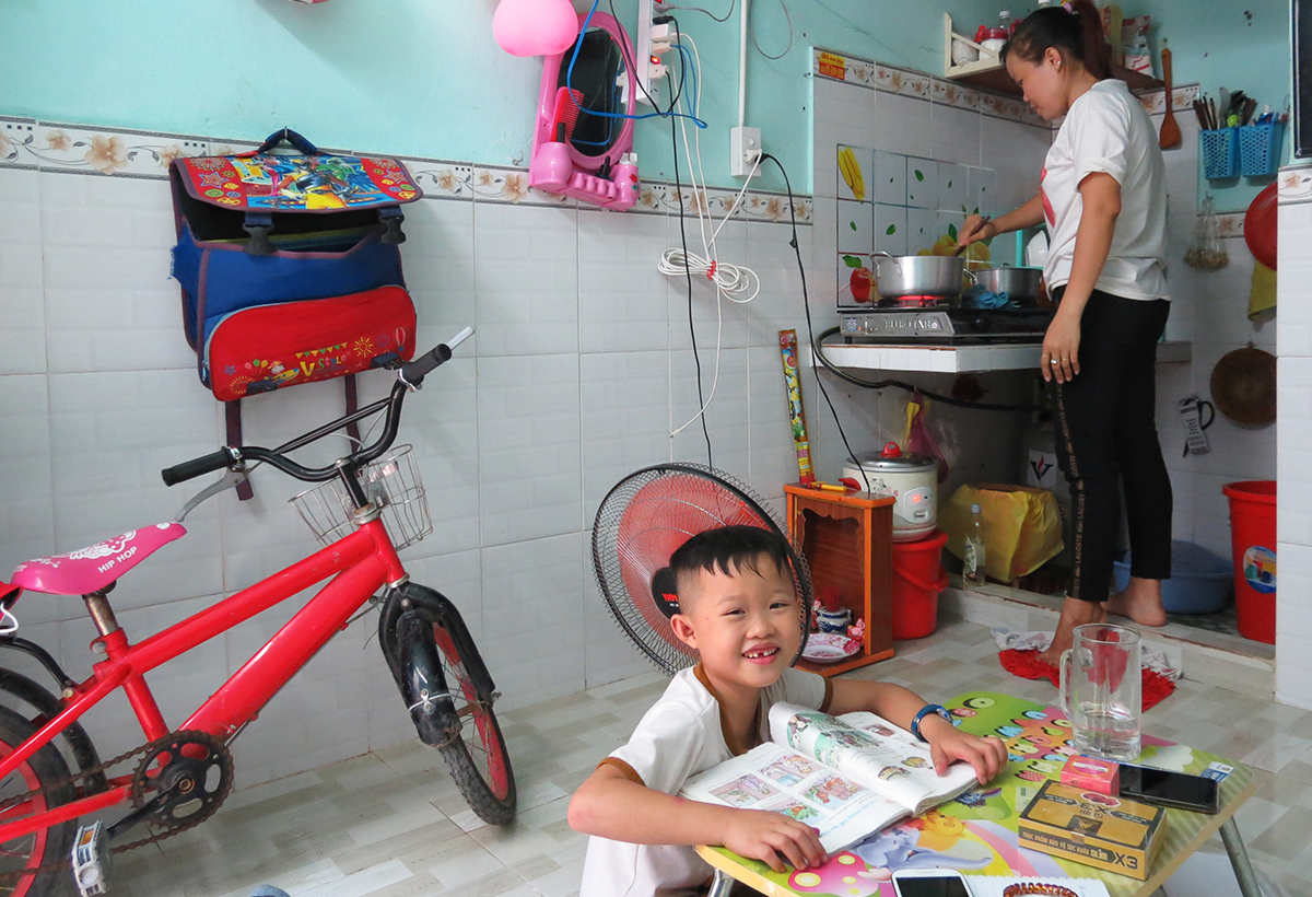 Tinh and her son in their apartment in Saigons Binh Tan District. Photo by VnExpress/Lam Son.