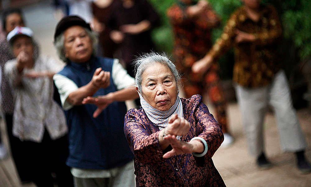 Elderly people exercise in a park in Hanoi. Photo by Reuters/Damir Sagolj.