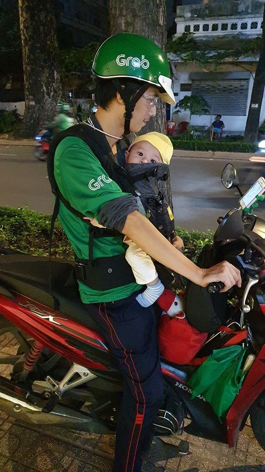 Hieu and his little son on a Saigons street. Photo courtesy of Hieus passenger.