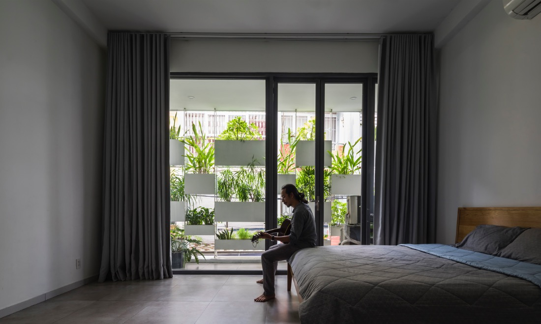 Minimalist bedroom with a green view.