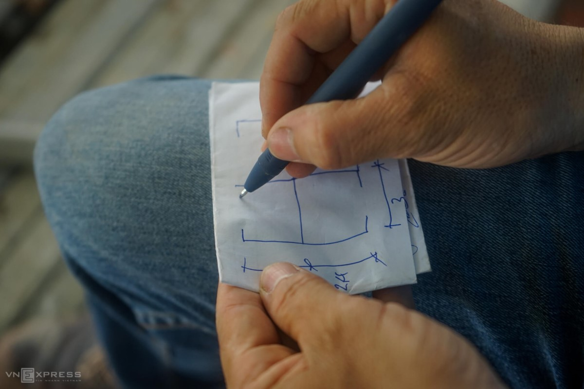 An engineer for the project sketches a blueprint for a hospital room. Hospital rooms are expected to be made from steel frames, spanning 2.4m on each side.