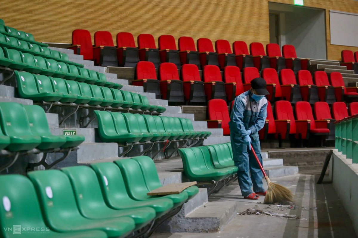 A worker cleans up the audience area. The area would be used as a resting place for medical personnel and patients family members.
