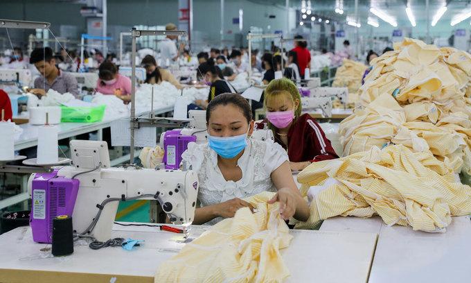 New wave of Covid-19 to threaten still-struggling garment industry -  VnExpress International