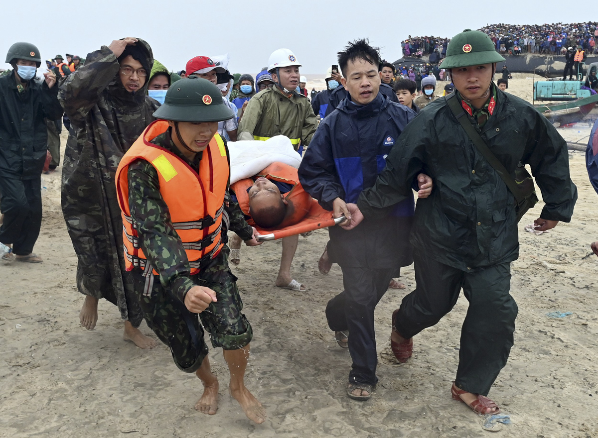 After one and a half hour, the fisherman is brought safely to land and immediately sent to emergency aid as watched by hundreds of local people.