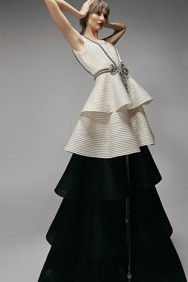 A two-piece evening gown that has a layered flow.