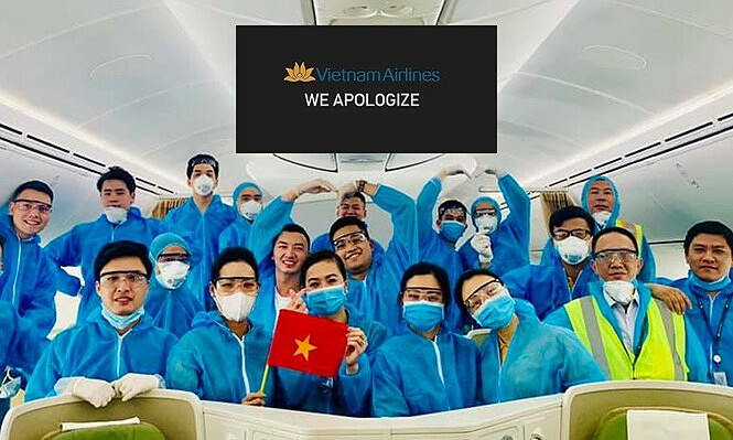 Vietnam Airlines staff on a flight during the Covid-19 pandemic. Photo courtesy of Tien Phong Newspaper.
