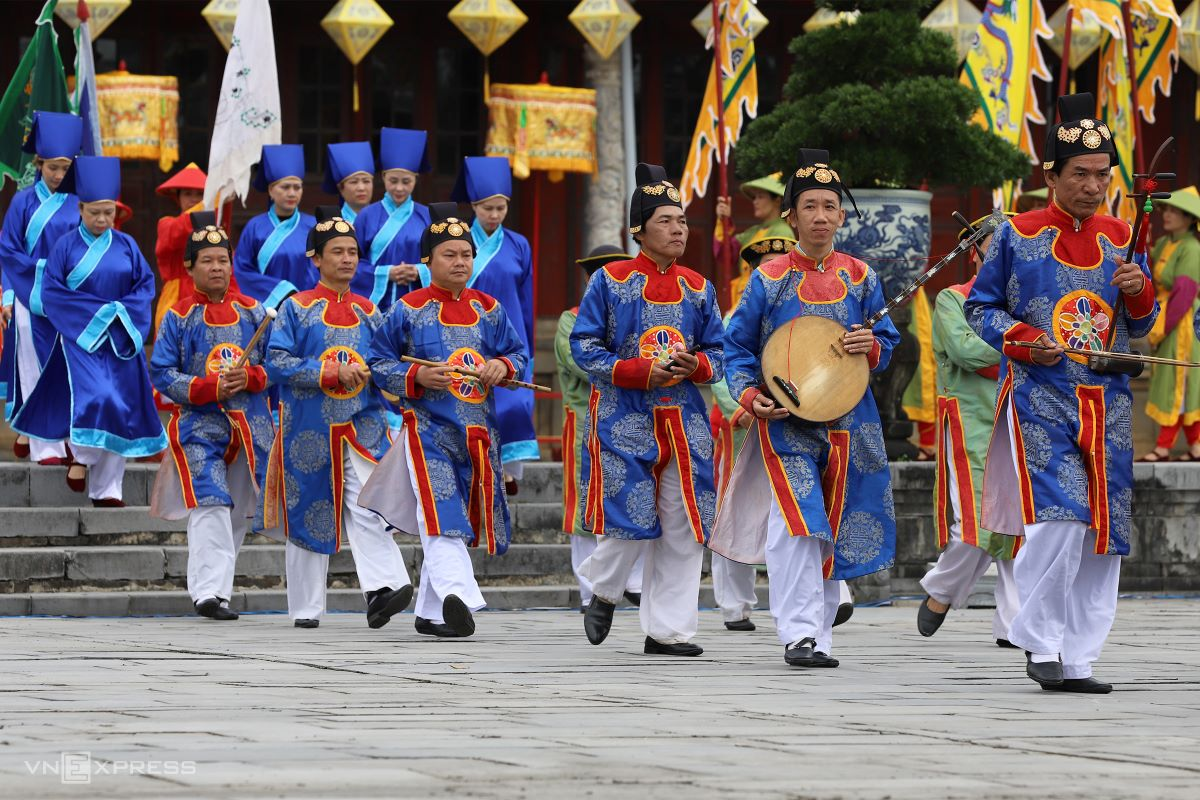 The music performance for the Grand Audience Ceremony is attended by a group of Hue royal court artists.
