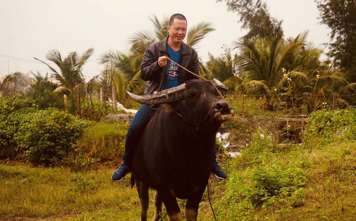 Khoa riding a buffalo. Photo courtesy of Tran Van Khoa.