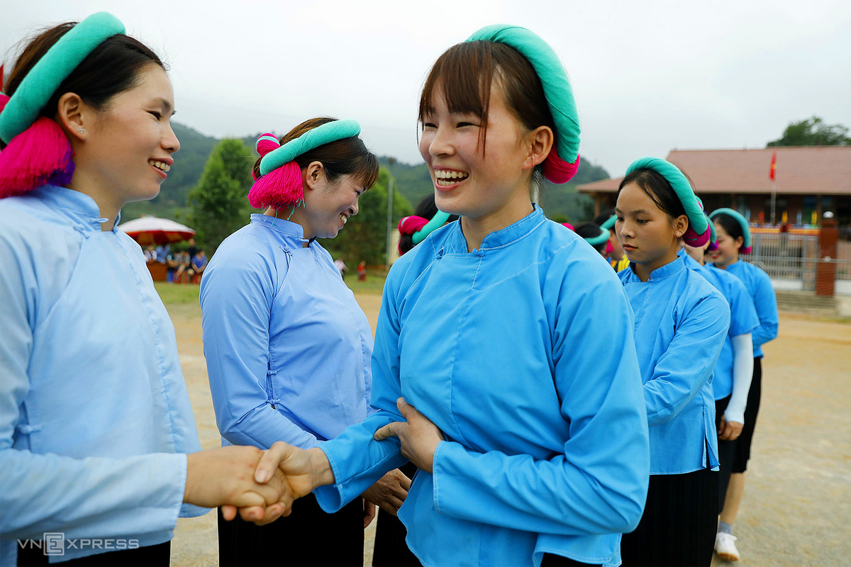 Ethnic women play football in skirts