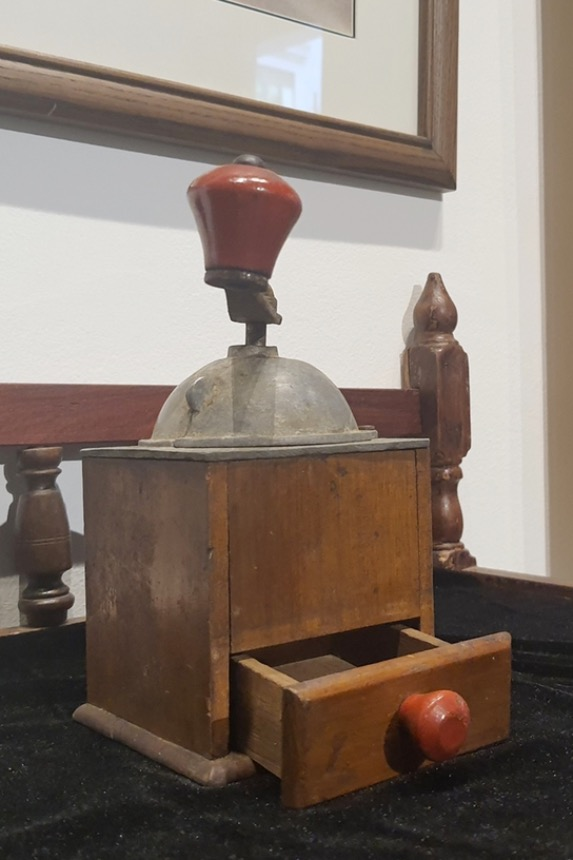 A pepper mill made of wood and metal from the 1930s.