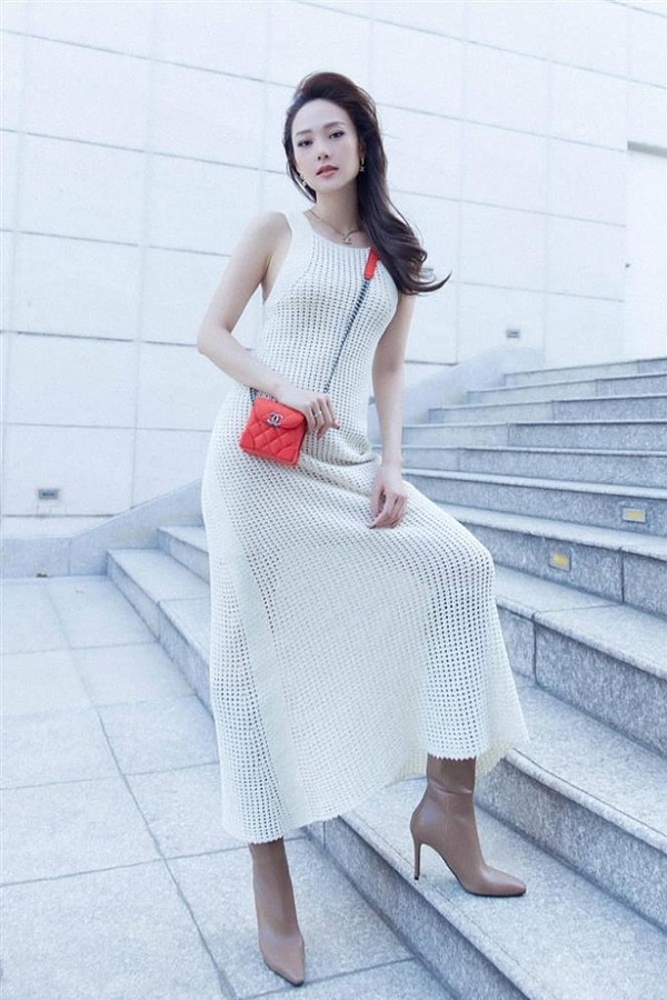 Singer Minh Hang opts for a knitted dress with leather boots.