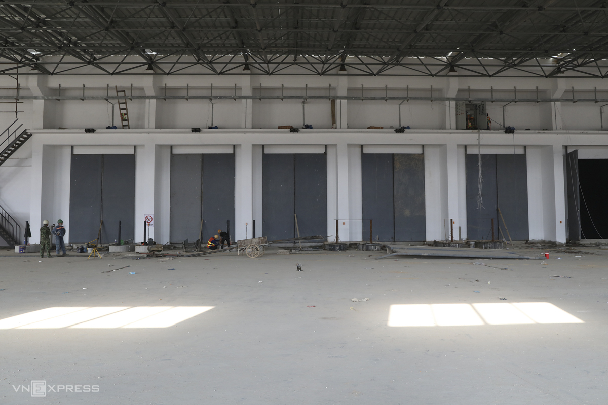 The factory has 16 doors suited to different types of garbage trucks currently used in Vietnam.