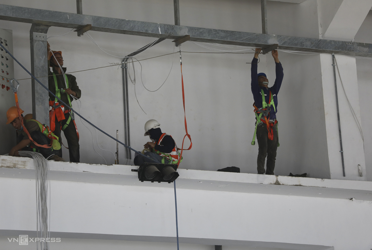 Workers install the electricity system inside the plant.