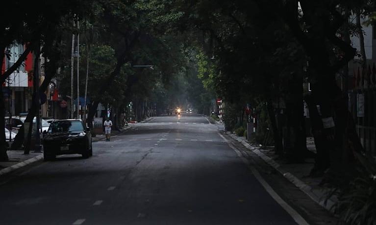 A man jogs on Ba Trieu Street at 5:30 a.m., July 24, 2021.