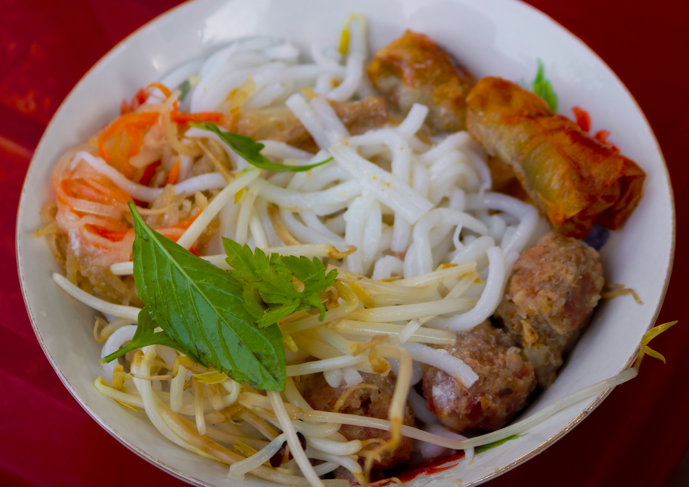 Banh tam noodles are different across different Mekong Delta provinces, depending on the type of rice available in the area and the noodle-making process. No one knows exactly the origin of the dish but many people in the Mekong Delta believed that it originated from Bac Lieu Province. The main ingredients of this dish are thick noodles made of rice flour and tapioca flour, shredded pork skin, herbs, coconut cream and sweet fish sauce.