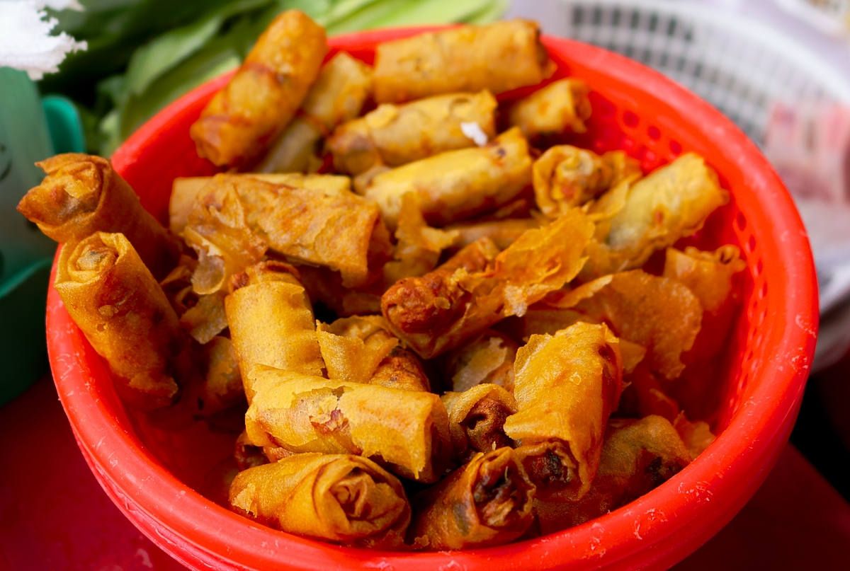 Unlike banh tam bi dish found in Saigon stalls, this version in An Giang is added with fried spring rolls that makes the dish more tasting.